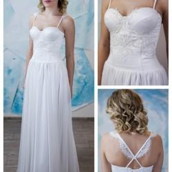 vestuvines suknele su lengvu sijonu ir plonom, dekoruotom petneselem