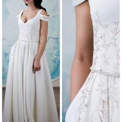 vestuvine suknele su kisenemis, nuleistomis petnesomis ,