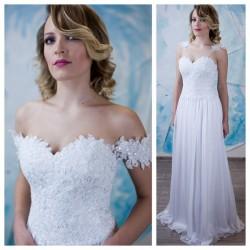 vestuvine suknele su lengvu sijonu, nukritusiom petneselem